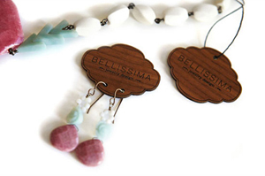 Designed custom hang tags for Bellissima Jewelry Design. The main goal was to really have the tag stand out when placed around other products in stores.  We ended up having an earring and necklace version laser cut into maple veneer wood.