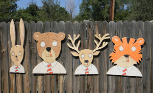 Wood busts of animals with bloody noses.  An ongoing series that was started February 2011.