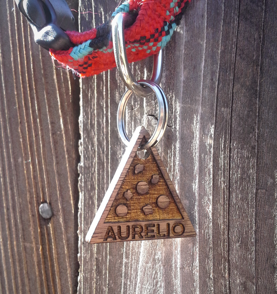 I designed a custom wood dog tag for our new little guy, Aurelio.  He's named after my favorite pizza spot, so I thought it would be fitting for him to have a pepperoni and sausage slice for the tag design.  Back of the tag has the contact info.  My friend Roger did the killer lasering job.